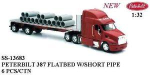 Peterbilt 379 with Sleeper and Flatbed Trailer Hauling Short Construction Pipes