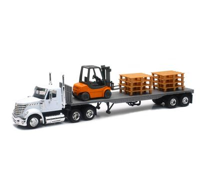 International Lonestar with Flat Bed Hauling a Forklift and Pallets