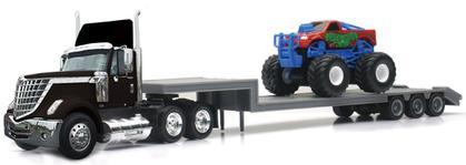 International Lonestar with Lowboy Trailer Hauling a Monster Truck