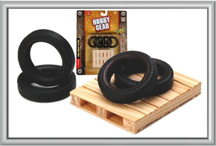 Set of Spare Tires and Wood Pallet.