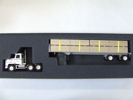 Mack Truck - Flat Bed with a Cargo of  Wood